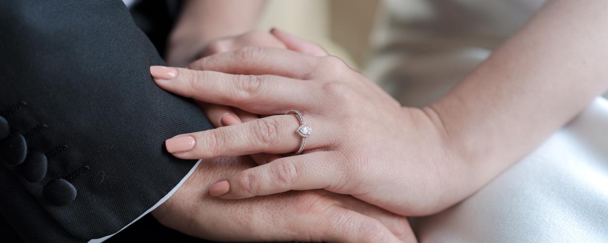 wedding couple with diamond ring