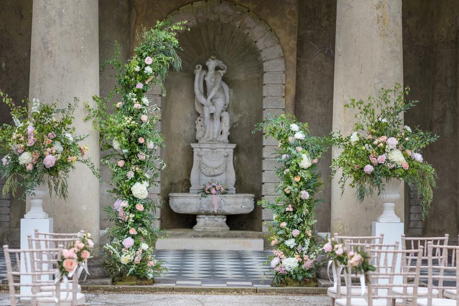 Outdoor wedding ceremony in Italian Garden at Wotton House, Dorking