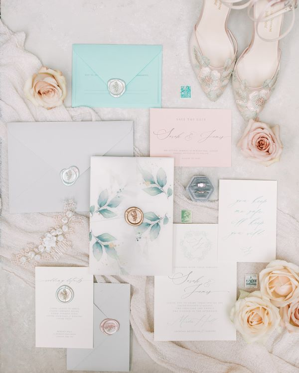 Calligraphy wedding stationery with roses and flower detail wedding shoes