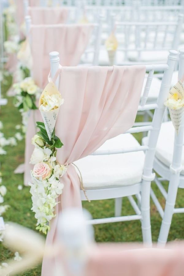 Draped ceremony chairs with chiffon and floral ties