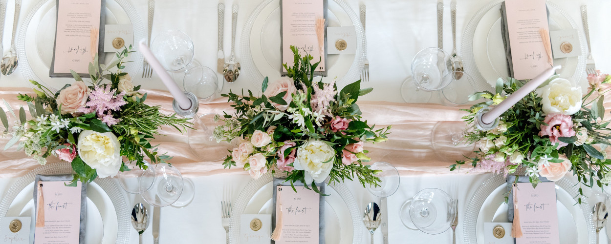 Wedding table with place setting and centrepieces