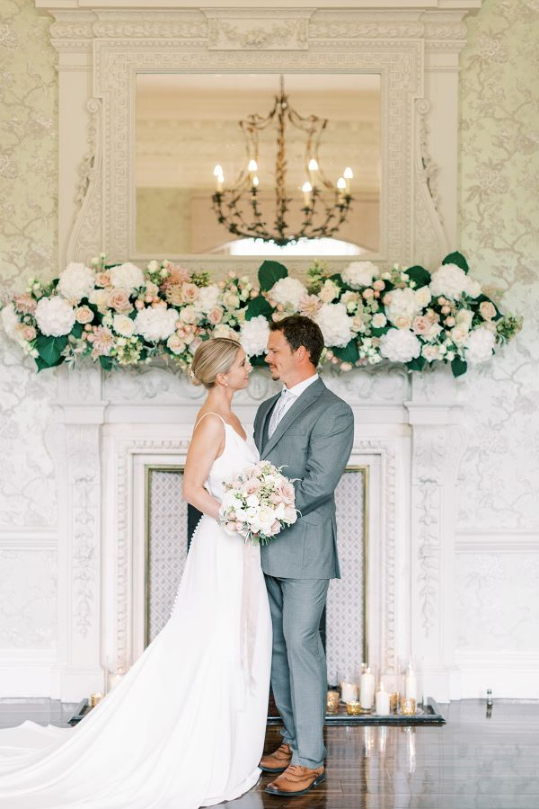 Wedding couple at Morden Hall, with flowers and bouquet