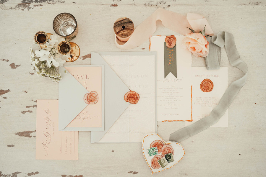 blush and grey wedding stationery with ribbons and wax seals
