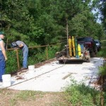 Volunteers installing side-railing on Bowie Co s famous Holy Bridge 2009