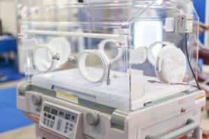 Empty infant incubator in an hospital room. Nursery incubator in hospital.