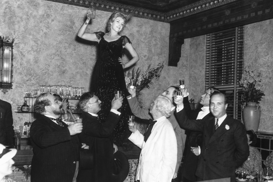Toast during New Year's eve party --- Image by © Bettmann/CORBIS