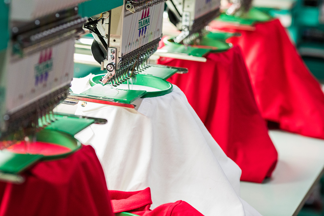 Offering multiple garment colors can add diversity while still reflecting the brand image properly.
