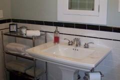 Large Pedistal Sink with Marble Floors