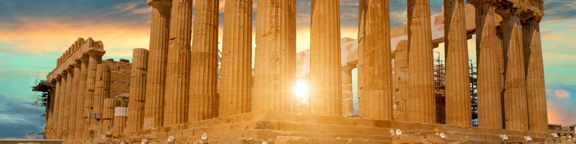 Sun rising behind the Parthenon at the Acropolis
