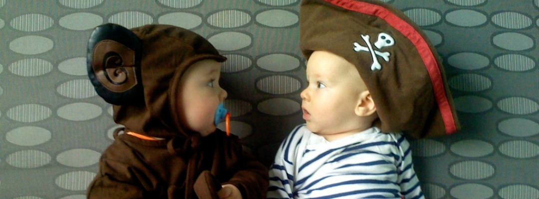 two-babies-dressed-up-in-halloween-costumes