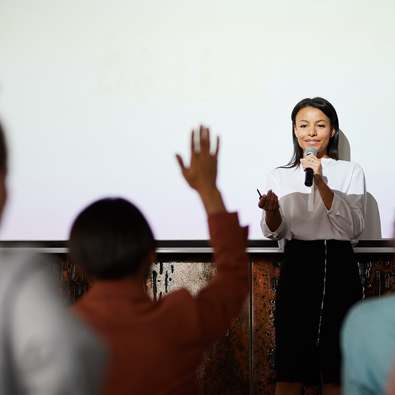 no_men_small_businesswoman-speaking-at-conference-QEX8B6J