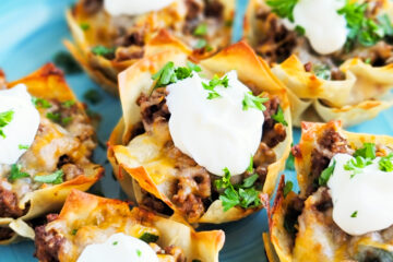 Easy Cheesy Taco Cups! Perfect for Taco Tuesday made with wontons, taco meat, sour cream. beautifuleatsandthings.com