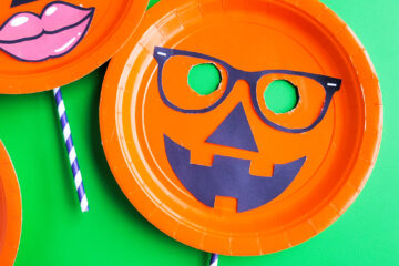 DIY Halloween Pumpkin Masks made with orange Paper Plates and cut out faces littleeatsandthings.com