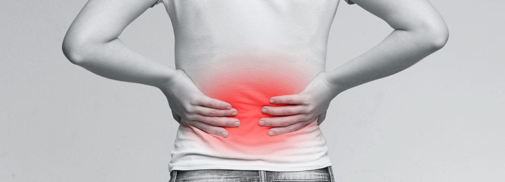 woman suffering from chronic back pain