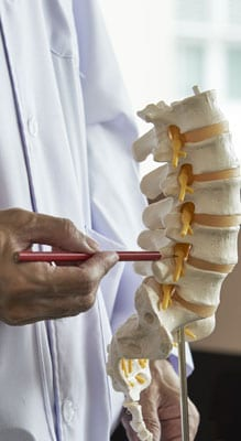 Doctor Showing Spine Injection