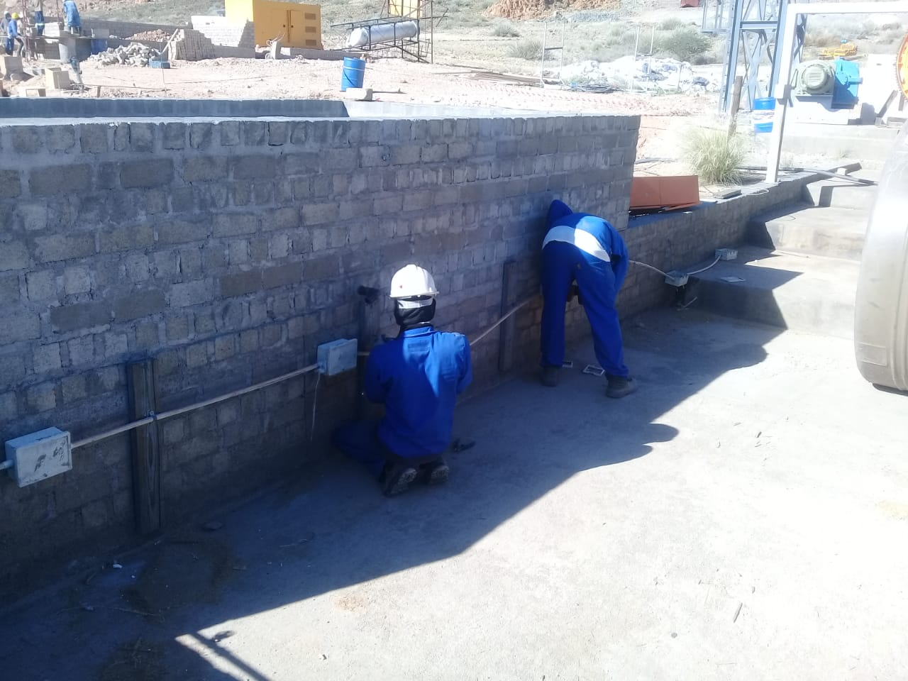 Aukam Workers installing electrical components on site at the Aukam Vein Graphite Project in Namibia, Africa