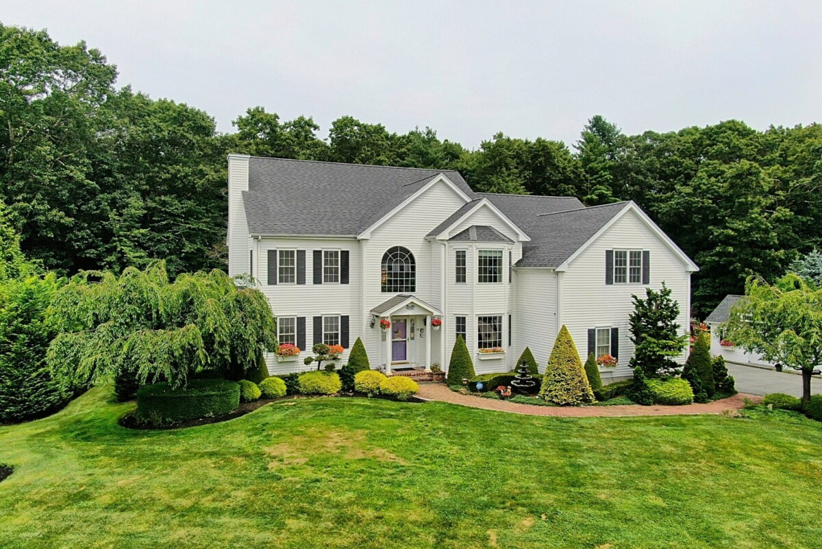 Aerial (drone) image of a 2-story colonial style home in West Bridgewater, MA.