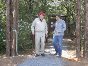 HWT board members Dick Udouj and Dustin Collyge walking the trail