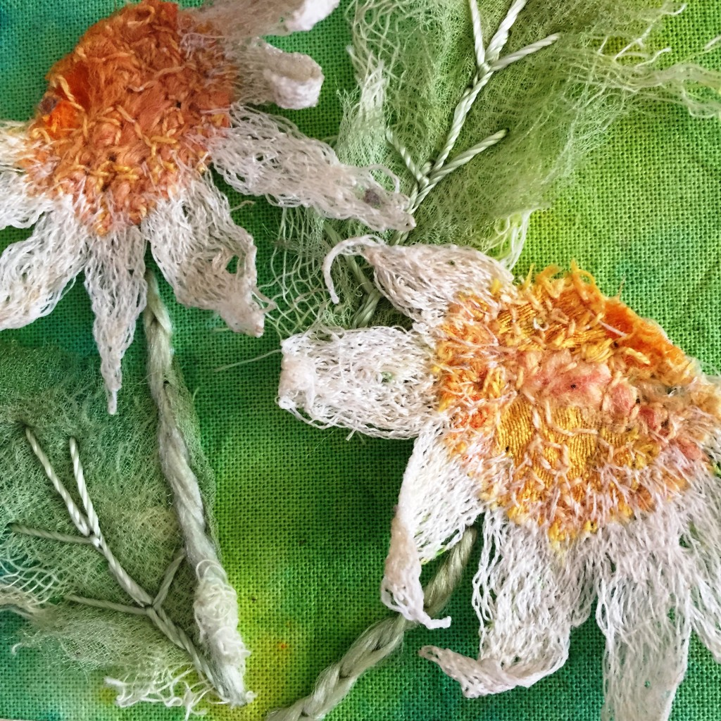 Close up of daisy embroidery www.kateskloths.co.uk