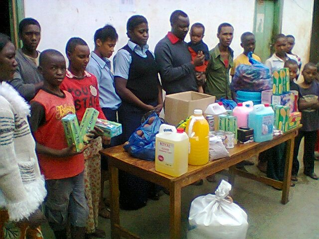 Owner & employees of Babati's Ziggy Supermarket bringing donations for our chidren