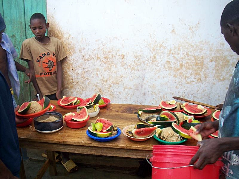 Easter meal of pilau, watermelon, oranges and bananas (2011)