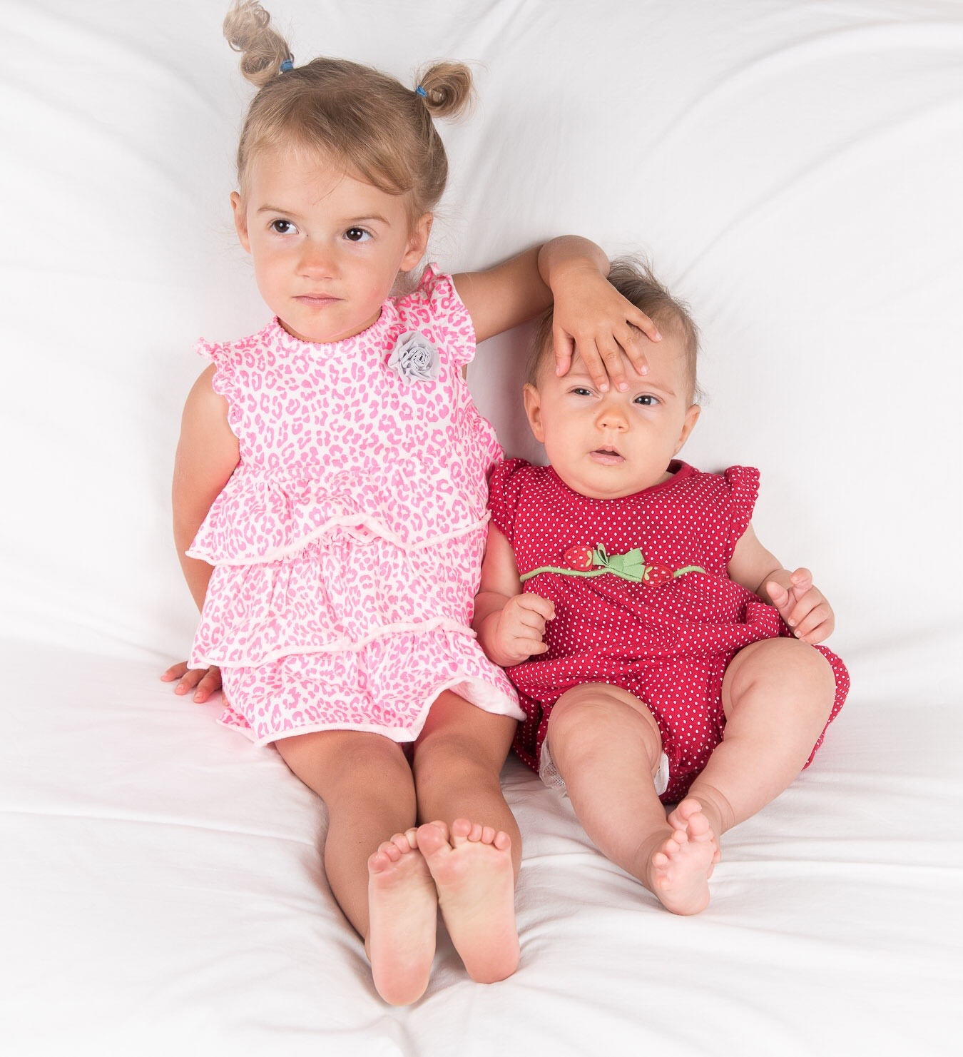 Sienna (2 years) with her younger sister (3 months)
