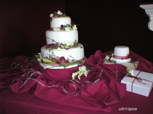 Beautiful lily adorned wedding cake   urbnspice.com