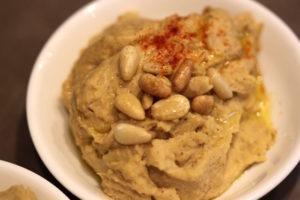 Hummus with toasted pine nut garnish | urbnspice.com