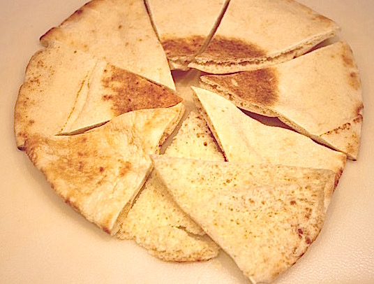 Parmesan Pita Crisps: 1st step cutting the pitas and separating the pieces into two | urbnspice.com