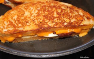 The slow grilling of the Grilled Double Cheese Bacon Sandwich rewards you with a golden crispy crust   urbnspice.com