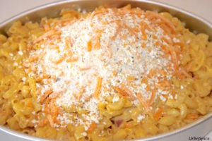 Adding topping to the baking dish for the Ultimate Mac and Cheese | urbnspice.com