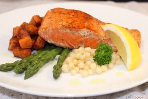 Chive Oil is drizzled onto a plated salmon dish | urbnspice.com