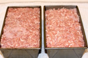 Ground Pork and Ham mixture is pressed firmly into the loaf pan   urbnspice.com