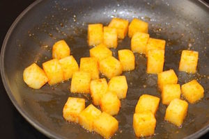 Potatoes are sprinkled with paprika and sauteed | urbnspice.com