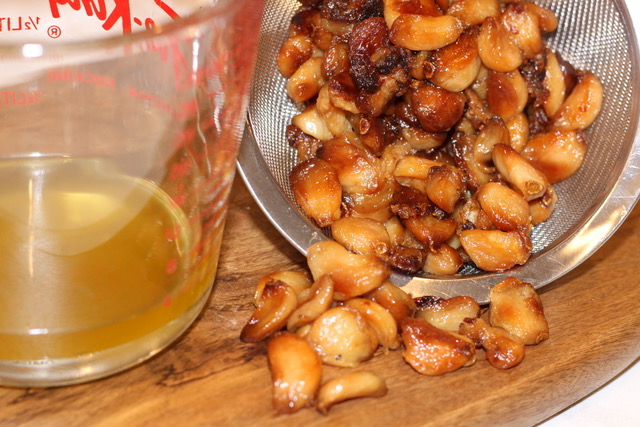 The caramelized Garlic is strained and the garlic oil is reserved | urbnspice.com