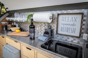 Stainless Steel Countertop and Backsplash with Glass Top Sink