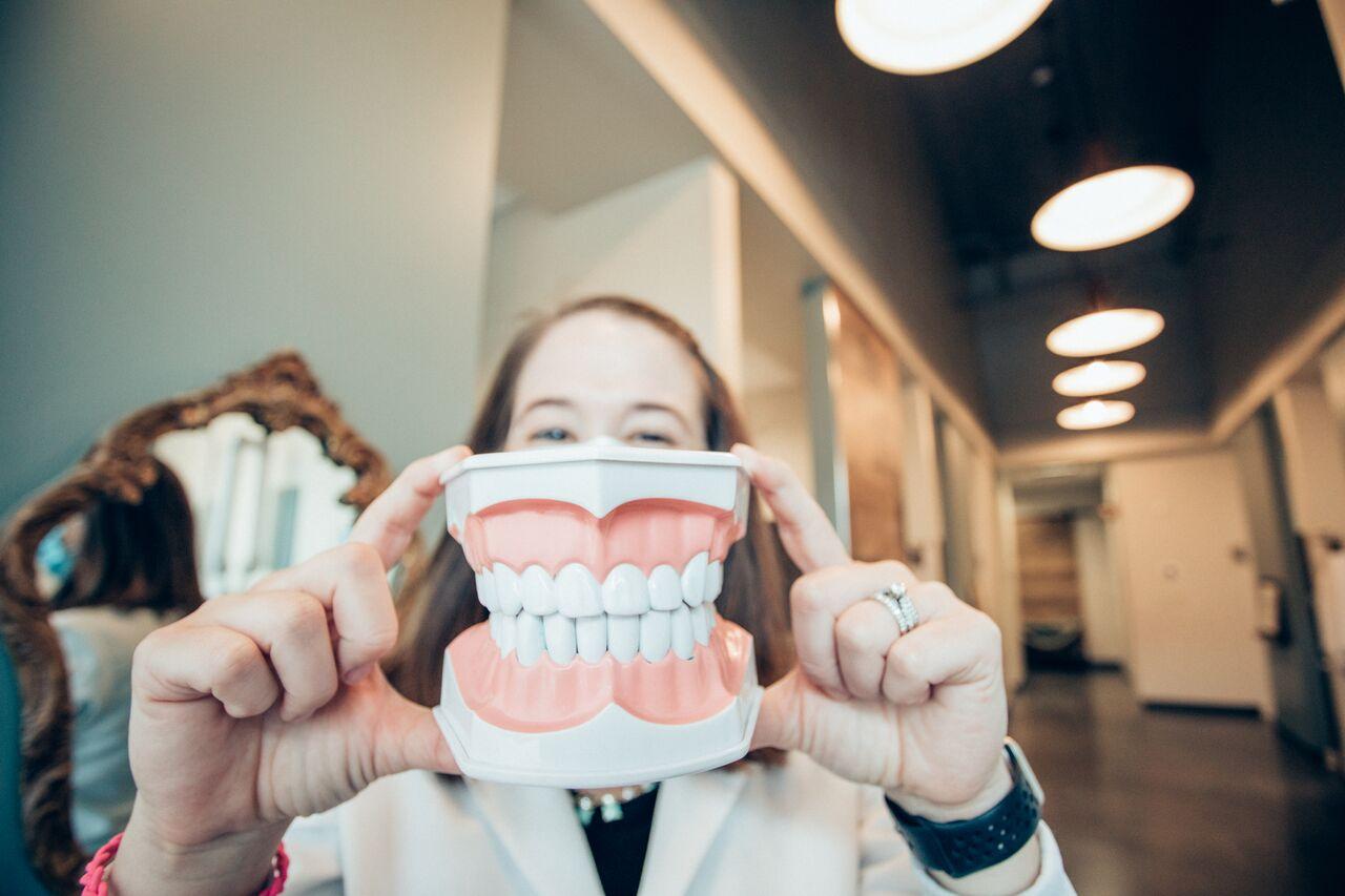 woman holding teeth