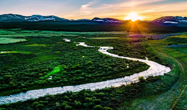 River at sunset with mountain background