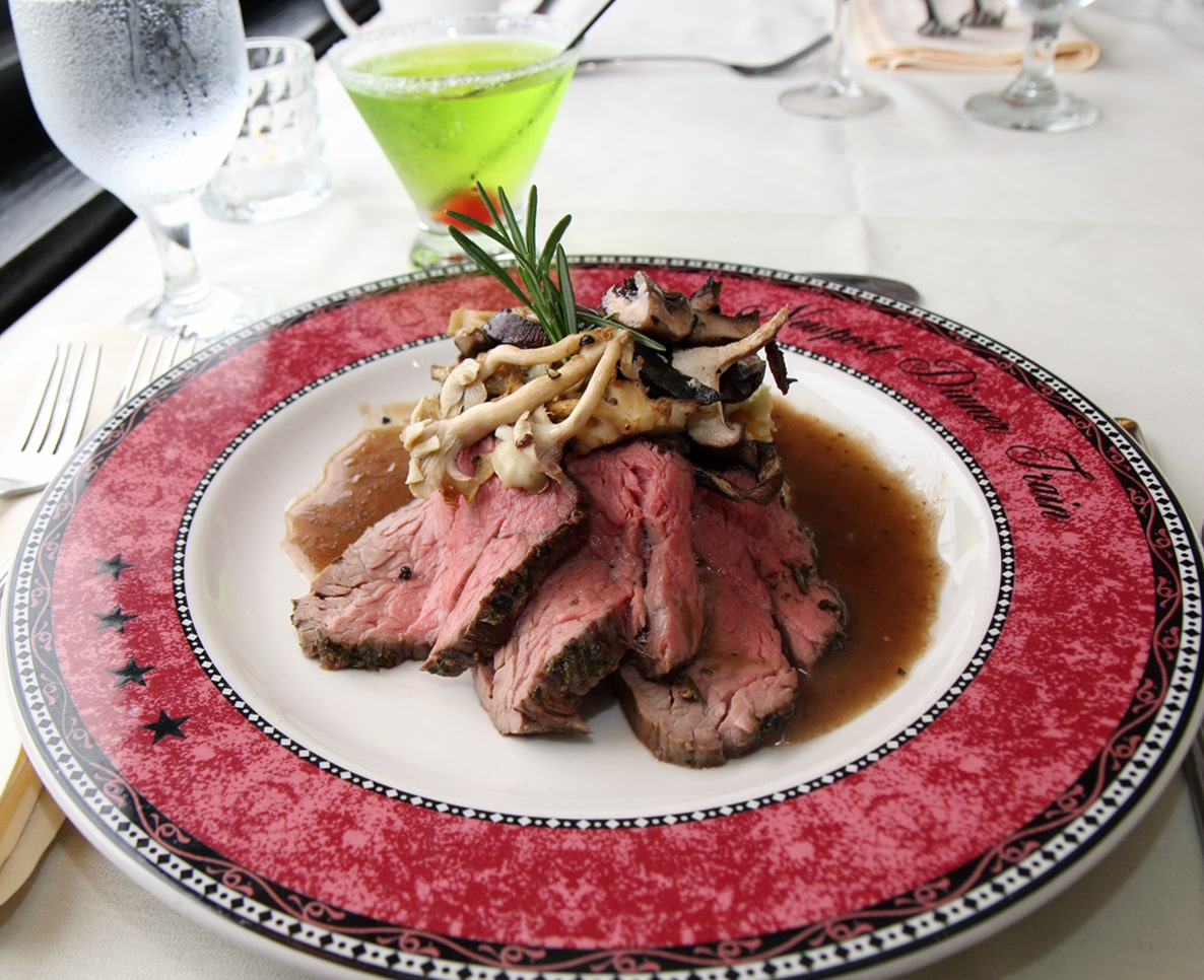 gourmet beef dish at the Grand Bellevue train