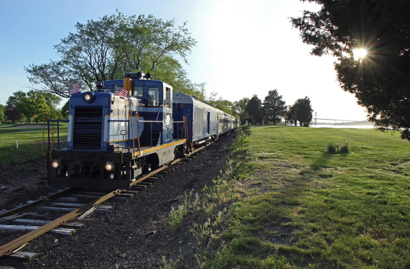 Grand Bellevue train passing by a golf course in Rhode Island