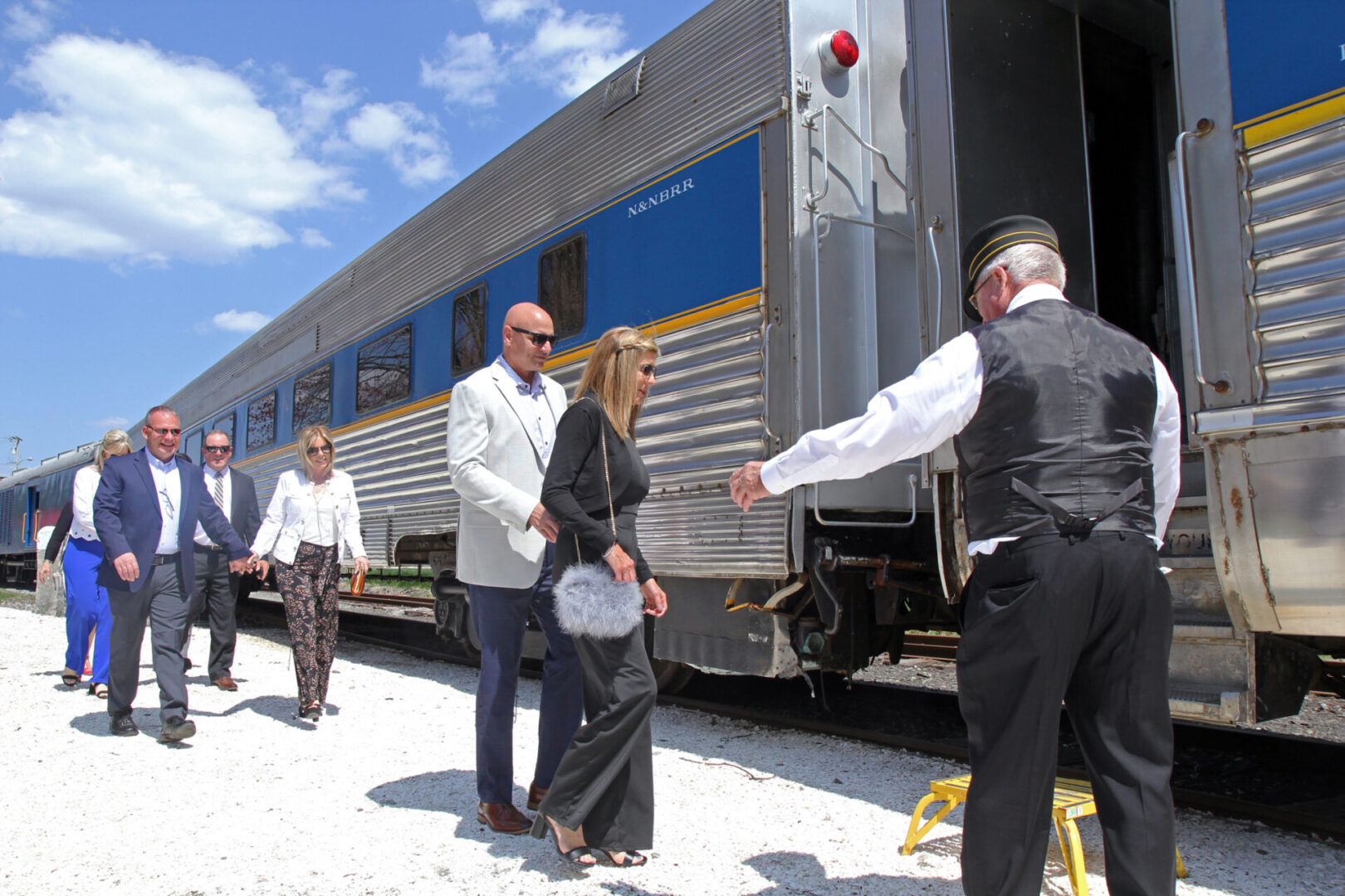 welcoming guests aboard the Grand Bellevue train