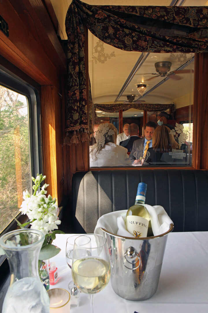window seat view and diners at the Grand Bellevue train