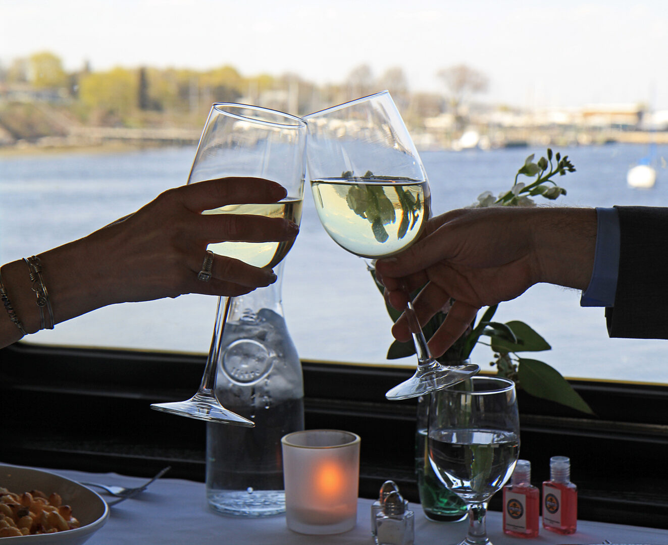 toasting to a beautiful view and delicious dinner aboard the Grand Bellevue train