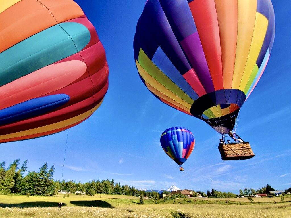 Three hot air balloons launching in washington state