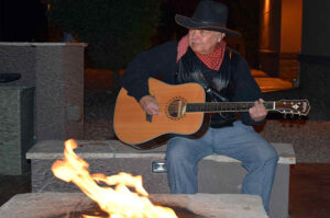 A man playing his guitar