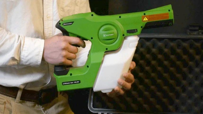 Man holding a high-tech green sprayer