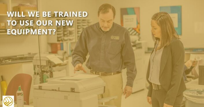 Training on how to use a new copier from Advanced Imaging Solutions