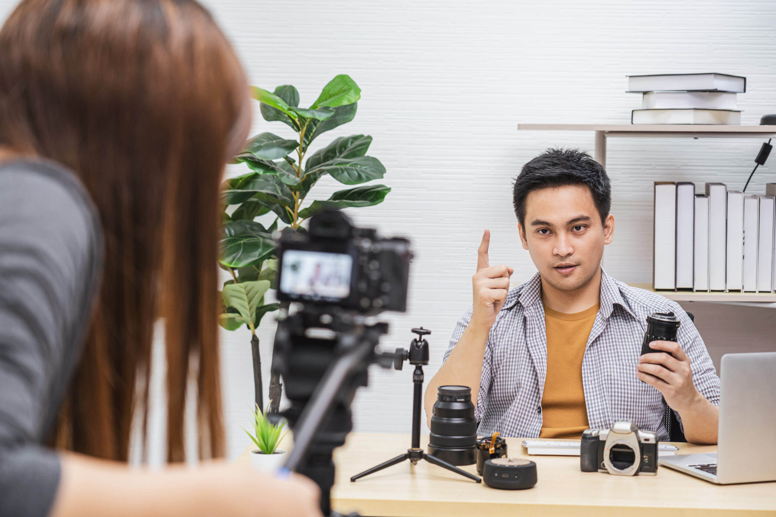Camera taking video and live with laptop of Vlogger man