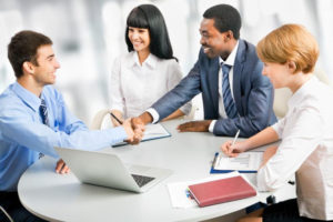 group of business people gathered around a table - https://sclequipmentfinance.com/