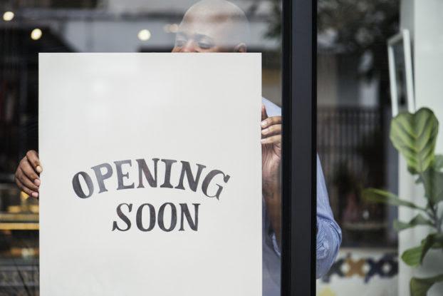 Opening Soon sign in shop window